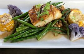 Sablefish with green beans, corn coins, and purple broccoli